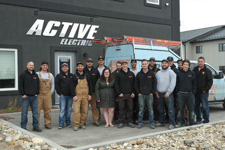 Team Photo In-front of Active Electric Building